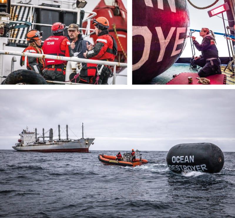 """Auf dem Kühlschiff """"Taganrogskiy Zaliv"""" überprüfen Greenpeace-Aktivistinnen und -Aktivisten die Ladung und entdecken unerlaubt gefangenen Tintenfisch. Das luftgefüllte Fundstück bemalt die Greenpeace-Crew mit der Botschaft """"Ozeanzerstörer"""" und zeigt, wie unverantwortlich die Fischereibranche agiert"""