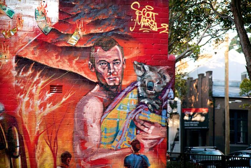 """Inspiriert vom Greenpeace-Dokumentarfilm """"Dirty Power: Burnt Country"""" (youtu.be/4FjmlNo-Ai8) entwarf der Künstler Scott Marsh in Sydney dieses Wandbild. Er versteht sein Werk als Protest gegen die Verursacher der Buschbrände"""